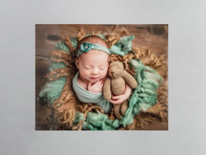 newborn image on a matte print
