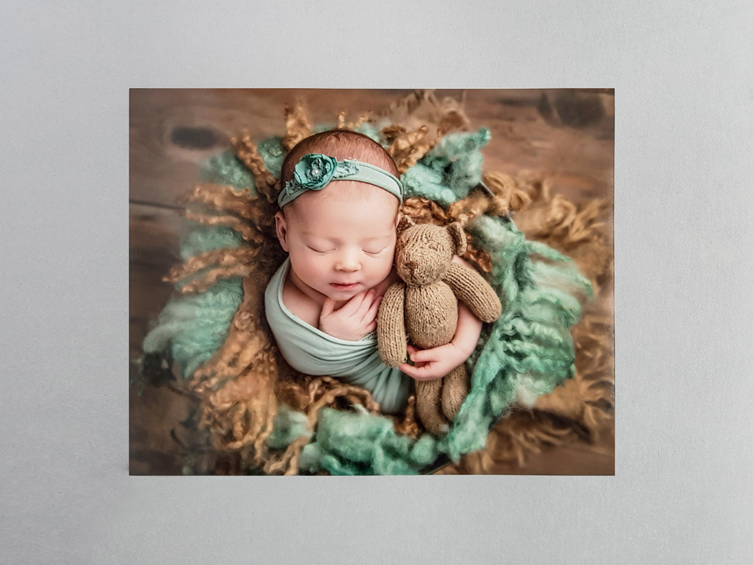 newborn image on a matte print